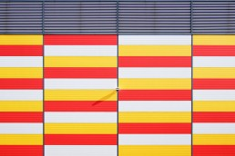 Alarm-System-mounted-on-side-of-red-yello-white-building