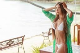 Beautiful-girl-in-white-bikini-relaxing-in-vacation-retreat