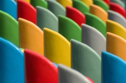 Chair backs of differing bright primary colors