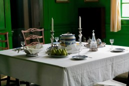 HomeDecorAtlanta - Dining Table with Place Settings in Dark Green Room