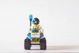 Lego Policeman riding an ATV