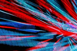 Long exposure of red cyan and blue lights in an abstract pattern