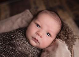 Newborn child wrapped in wool blanket