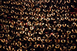 Overhead snapshot of college graduates standing at graduation ceremony