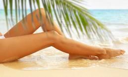 Woman in bikini sitting in the sand