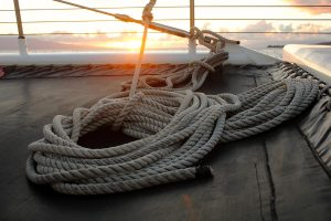 Sunset view from cataman with tie rope in foreground