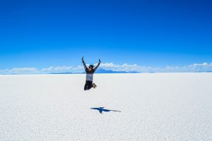 Girl-jumping-while-at-the-Bonneville-Salt-Flats