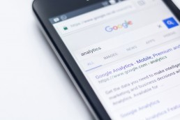 Closeup-shot-of-phone-displaying-Google-Analytics-search-results